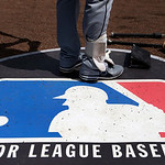 Cleveland Indians second baseman Jason Kipnis stands on the Major League Baseball logo that serves as the on deck circle during the first inning of a baseball game between the Chicago White  …