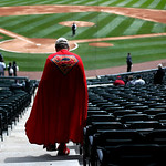 Joseph H. Horn, whose legal name is Superman J.H. Horn, walks down to the field at U.S. Cellular Field before a baseball game between the Chicago White Sox and the Cleveland Indians  Wednesd …