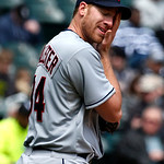 Cleveland Indians starting pitcher Zach McAllister wipes the sweat from his face during the third inning of a baseball game against the Chicago White Sox Wednesday, April 24, 2013, in Chicag …