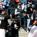 Chicago White Sox's Jeff Keppinger (7) greets Alex Rios at home after the pair scored on Rios' home run off Cleveland Indians starting pitcher Zach McAllister during the fifth inning of a ba …