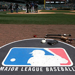 The Major League Baseball logo serves as the visitor's on deck circle before a baseball game between the Chicago White Sox and the Cleveland Indians Wednesday, April 24, 2013, in Chicago. (A …
