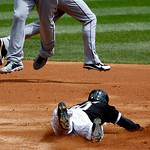 Chicago White Sox's Alejandro De Aza (30) steals second as Cleveland Indians second baseman Jason Kipnis, left, catches a high throw from Lou Marson, as shortstop Mike Aviles, background, ru …