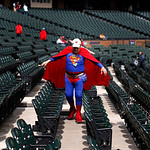 Joseph H. Horn, whose legal name is Superman J.H. Horn, walks to his seat at U.S. Cellular Field before a baseball game between the Chicago White Sox and the Cleveland Indians  Wednesday, Ap …