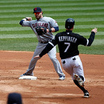 Cleveland Indians second baseman Jason Kipnis, left, turns the double play forcing Chicago White Sox's Jeff Keppinger at second and getting Alex Rios at first during the first inning of a ba …
