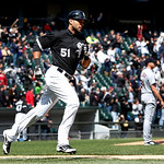 Chicago White Sox's Alex Rios heads to first after hitting a two-run home run off Cleveland Indians starting pitcher Zach McAllister, background right, during the fifth inning of a baseball  …