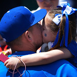 Kansas City Royals' Billy Butler gets a kiss from one of his daughters before the first of two baseball games against the Cleveland Indians, Sunday, April 28, 2013, in Kansas City, Mo. (AP P …