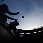 Fans try for autographs before the second baseball game of a doubleheader between the Kansas City Royals and the Cleveland Indians, Sunday, April 28, 2013, in Kansas City, Mo. (AP Photo/Reed …