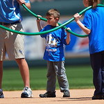 Some small fans helped the Kansas City Royals grounds crew wet down the infield prior to the start of the baseball game between between the Kansas City Royals and the Cleveland Indians. Sund …