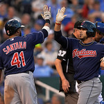 Cleveland Indians' Mike Aviles, right, celebrates with teammate Carlos Santana after hitting a three-run home run in the third inning of their second baseball game against the Kansas City Ro …