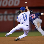 Kansas City Royals second baseman Chris Getz (17) was charged with an error while trying to throw out Cleveland Indians' Carlos Santana stealing second base in the seventh inning of their se …