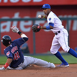Cleveland Indians' Carlos Santana (41) is forced out at second by Kansas City Royals shortstop Alcides Escobar (2) in the first inning of their two baseball games, Sunday, April 28, 2013, in …