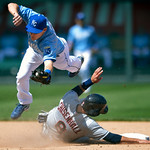 Kansas City Royals second baseman Chris Getz, top, gets the force-out on Cleveland Indians' Lonnie Chisenhall (8) at second during the seventh inning of the first of two baseball games on Su …