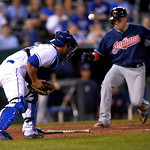 Cleveland Indians' Asdrubal Cabrera scores ahead of the throw to Kansas City Royals catcher George Kottaras (26) in the eighth inning of their second baseball game of a doubleheader, Sunday, …