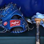 The Kansas City Royals' Eric Hosmer's glove sits in the dugout prior to the start of the first of their two baseball games against the Cleveland Indians, Sunday, April 28, 2013, in Kansas Ci …