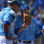 Kansas City Royals relief pitcher Tim Collins (55) talks with Kansas City Royals catcher Salvador Perez (13) during the seventh inning of the first of their two baseball games, Sunday, April …