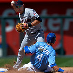Kansas City Royals' Alex Gordon (4) is forced out but breaks up a double play-attempt by Cleveland Indians shortstop Asdrubal Cabrera, top, during the seventh inning of the first of two base …