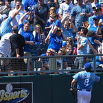 The Royals' fans got this foul ball in front of Kansas City Royals third baseman Mike Moustakas (8) during the seventh inning of the first of their two baseball games against the Cleveland I …