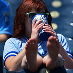 This fan was taking advantage of the beautiful day at the ballpark as she waited for the start of the baseball game between the Kansas City Royals and the Cleveland Indians. Sunday, April 28 …