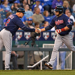 Cleveland Indians' Mike Aviles is congratulated by Brad Mills (2) while rounding third after hitting a home run against the Kansas City Royals in the third inning of their second baseball ga …