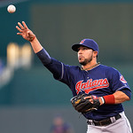 Cleveland Indians second baseman Mike Aviles throws to first for an out in the second inning of their second baseball game against the Kansas City Royals, Sunday, April 28, 2013, in Kansas …