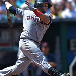 Cleveland Indians' Carlos Santana (41) strikes out during the seventh inning of the first of their two baseball games against the Kansas City Royals, Sunday, April 28, 2013, in Kansas City,  …