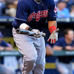 Cleveland Indians' Carlos Santana (41) sprints to first on an RBI single against the Kansas City Royals in the first inning of the second baseball game of a doubleheader, Sunday, April 28, 2 …
