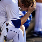 Kansas City Royals starting pitcher Will Smith rests in the dugout during the third inning of their second baseball game against the Cleveland Indians, Sunday, April 28, 2013, in Kansas City …