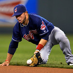 Cleveland Indians' Mike Aviles (4) picks up a ground ball from Kansas City Royals' Alex Gordon for an out at first in the seventh inning of their second baseball game of a doubleheader, Sund …