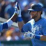 Kansas City Royals' Alex Gordon (4) celebrates his two-run home run with teammate Alcides Escobar during the eighth inning of the first of their two baseball games against the Cleveland Indi …