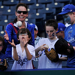 A young fan catches a ball autographed by Kansas City Royals' Billy Butler before a baseball game between the Royals and Cleveland Indians, Monday, April 29, 2013, in Kansas City, Mo. (AP Ph …