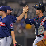 Cleveland Indians' Jason Giambi, left, celebrates with Yan Gomes after beating the Kansas City Royals, Monday, April 29, 2013, in Kansas City, Mo. (AP Photo/Reed Hoffmann)