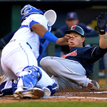Cleveland Indians' Asdrubal Cabrera is tagged out at home by Kansas City Royals catcher Salvador Perez during the first inning of a baseball game, Monday, April 29, 2013, in Kansas City, Mo. …