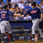 Cleveland Indians' Ryan Raburn is congratulated by teammate Mark Reynolds at home plate after hitting a home run during the fifth inning of a baseball game Monday, April 29, 2013, in Kansas …