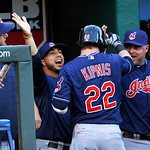 Cleveland Indians' Jason Kipnis (22) is congratulated by Mike Aviles, center left, and teammates after hitting a solo home run during the first inning of a baseball game against the Kansas C …