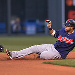 Cleveland Indians' Carlos Santana slid right into the tag of Kansas City Royals second baseman Chris Getz for an out during the fourth inning of a baseball game  Monday, April 29, 2013, in K …