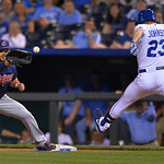 Kansas City Royals' Elliot Johnson (23) can't beat this throw to Cleveland Indians first baseman Nick Swisher during the eighth inning of a baseball game  Monday, April 29, 2013, in Kansas C …
