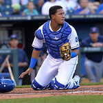 Kansas City Royals catcher Salvador Perez checks the field after tagging out Cleveland Indians' Asdrubal Cabrera at home plate during the first inning of a baseball game between the Kansas C …