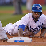 Kansas City Royals' Lorenzo Cain dives back to first base during the second inning of a baseball game against Cleveland Indians, Monday, April 29, 2013, in Kansas City, Mo. (AP Photo/Reed Ho …