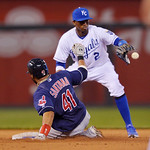 Cleveland Indians' Carlos Santana (41) is safe at second ahead of this throw to Kansas City Royals shortstop Alcides Escobar (2) for an RBI double during the fifth inning of a baseball game …