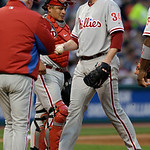 Philadelphia Phillies starting pitcher Roy Halladay (34) hands the ball to manager Charlie Manuel in the fourth inning of a baseball game against the Cleveland Indians, Tuesday, April 30, 20 …