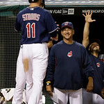 Cleveland Indians manager Terry Francona, right, smiles as he waits for Drew Stubbs (11) after Stubbs hit a solo home run off Philadelphia Phillies relief pitcher Raul Valdes in the seventh  …