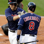 Cleveland Indians' Mark Reynolds, left, is congratulated by Lonnie Chisenhall after Reynolds hit a two-run home run off Philadelphia Phillies starting pitcher Roy Halladay during the first i …