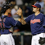 Cleveland Indians relief pitcher Matt Albers, right, is congratulated by catcher Yan Gomes after the Indians defeated the Philadelphia Phillies 14-2 in a baseball game, Tuesday, April 30, 20 …