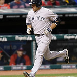 New York Yankees' Kevin Youkilis runs the bases after hitting a two-run home run off Cleveland Indians relief pitcher Brett Myers in the sixth inning of a baseball game, Tuesday, April 9, 20 …