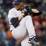 New York Yankees starting pitcher Andy Pettitte winds up in the seventh inning of a baseball game against the Cleveland Indians, Tuesday, April 9, 2013, in Cleveland. New York won 14-1. (AP …