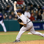 New York Yankees relief pitcher Adam Warren pitches in the ninth inning of a baseball game against the Cleveland Indians, Tuesday, April 9, 2013, in Cleveland. New York won 14-1. (AP Photo/T …
