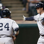 New York Yankees' Brennan Boesch, right, celebrates with Robinson Cano after the scored on Boesch's two-run home run off Cleveland Indians starting pitcher Brett Myers in the eighth inning o …