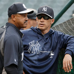 New York Yankees manager Joe Girardi, right, talks with bench coach Tony Pena during batting practice before a baseball game between Cleveland Indians and the Yankees on Tuesday, April 9, 20 …