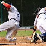 Boston Red Sox's Jacoby Ellsbury, left, slides safely home as Cleveland Indians catcher Lou Marson is late on the tag in the fifth inning of a baseball game, Thursday, Aug. 9, 2012, in Cleve …