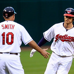 Cleveland Indians' Jason Donald, right, is congratulated by third base coach Steve Smith after Donald hit a solo home run in the first inning of a baseball game against the Boston Red Sox, T …